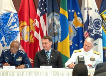 The President of Brazil Jair Bolsonaro (C) attends to a welcoming ceremony to the US Southern Command headquarters , in Miami, Florida, USA on 08 March 2020. Next to Bolsonaro is the Admiral Craig Faller, commander of the SOUTHCOM. The governments of Brazil and the United States of America signed the Research, Development, Test and Evaluation Agreement (RDT & E). The objective of RDT & E is to pave the way for the two governments to develop future joint projects aligned with the mutual interest of the parties, covering the possibility of improving or providing new military capabilities. (Brasil, Estados Unidos) EFE/EPA/CRISTOBAL HERRERA