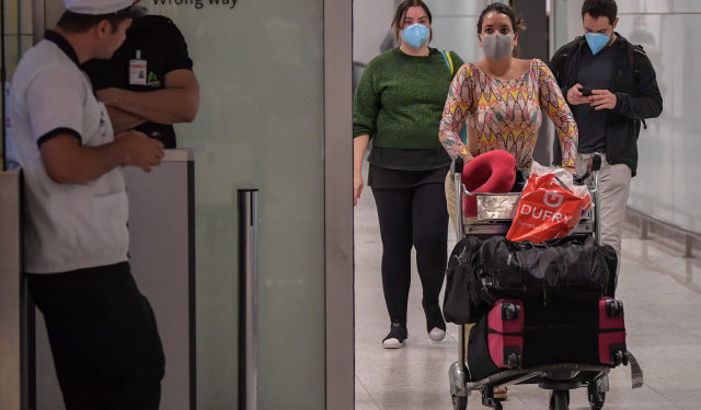 Passengers wearing masks as a precautionary measure to avoid contracting the new coronavirus, COVID-19, arrive on a flight from Italy at Guarulhos International Airport, in Guarulhos, Sao Paulo, Brazil on March 2, 2020. - The death toll from the new coronavirus epidemic surpassed 3,000 on Monday. The virus has now infected more than 89,000, spread to over 60 countries and threatens to cause a global economic slowdown -- after first emerging in China late last year. (Photo by Nelson ALMEIDA / AFP)