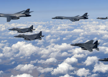 """This handout photo taken on September 18, 2017 and provided by the South Korean Defence Ministry in Seoul shows US Air Force B-1B Lancer bombers (L), US F-35B stealth jet fighters (far R) and South Korean F-15K fighter jets (foreground) flying over South Korea during a joint military drill aimed to counter North Korea's latest nuclear and missile tests. The US flew four stealth fighter jets and two bombers over the Korean peninsula on September 18 in a show of force after North Korea's latest nuclear and missile tests, South Korea's defence ministry said. / AFP PHOTO / South Korean Defence Ministry / handout / RESTRICTED TO EDITORIAL USE - MANDATORY CREDIT """"AFP PHOTO / South Korean Defence Ministry"""" - NO MARKETING NO ADVERTISING CAMPAIGNS - DISTRIBUTED AS A SERVICE TO CLIENTS"""