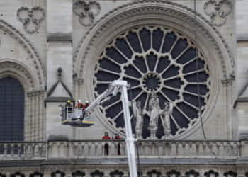 Firefighters secure Notre-Dame Cathedral in Paris on April 16, 2019, in the aftermath of a fire that caused its spire to crash to the ground. - Crowds of stunned Parisians and tourists -- some crying, others offering prayers -- watched in horror in central Paris on April 15 night as firefighters struggled for hours to extinguish the flames engulfing the Notre-Dame Cathedral. (Photo by Thomas SAMSON / AFP)